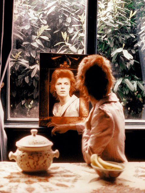 Mick Rock, David Bowie. In Mirror, Beckenham, 1972 © Mick Rock
