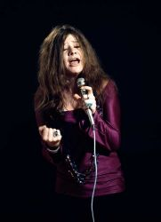 Janis Joplin American singer Janis Joplin (1943-1970) sings animatedly during a studio shoot for Eye magazine, which photographer Baron Wolman called the 'Concert for One' in Belvedere Street, San Francisco, January 1968.
